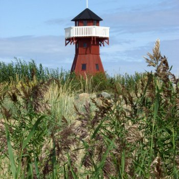 A red-ochre painted observation tower resembling a lighthouse stands at Varessäikkä point.