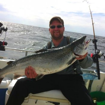 A 9.2 kg salmon caught during a fishing trip in a rental boat
