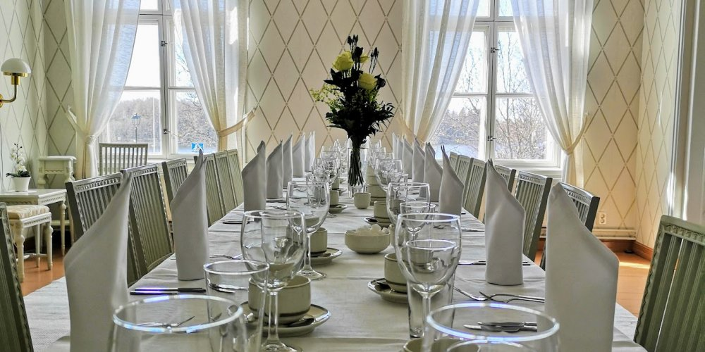 A festive dinner setting in a historic wooden house in Old Raahe.